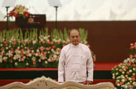 FILE - Myanmar's President Thein Sein, shown in Naypyitaw Aug. 8, 2014, has pledged to have cease-fire pacts with all ethnic groups before leaving office in 2015.