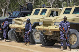 African Union (AU) soldiers stand with their armored vehicles near a checkpoint on the eve of presidential elections in Mogadishu, Somalia, Feb. 7, 2017.