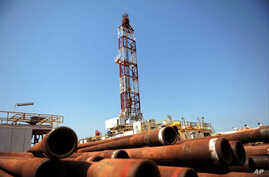 Drilling tubing is piled next to the drilling site number 102 in the Unity oil field in Southern Sudan ( November 2010 file photo)