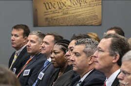 New immigration judges listen as Attorney General Jeff Sessions outlines Trump administration policies, in Falls Church, Va, Sept. 10, 2018.