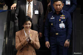 Thailand's Prime Minister Yingluck Shinawatra after a defense meeting in Bangkok March 4, 2014.