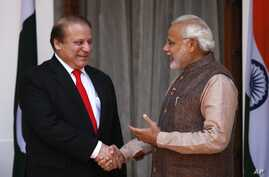 Indian Prime Minister Narendra Modi, right, shakes hand with his Pakistani counterpart Nawaz Sharif before the start of their meeting in New Delhi, India, May 27, 2014.