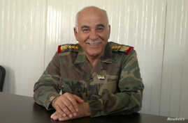 Syrian former army commander General Mustafa al-Sheikh is seen in an undisclosed location in this handout photo taken April 7, 2012. A former army commander who now leads a military council trying to organise armed resistance to Syrian President Bash