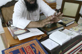 FILE - Judge Mufti Abdul Qayyum listens during the hearing of a divorce case at a Darul Qaza or Islamic Court in Ahmadabad, India.