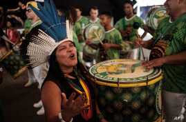 Sonia Guajajara (L), coordinator of the Articulation of the Indigenous Peoples of Brazil, and other indigenous leaders participate in the press conference given by the Imperatriz Leopoldinense samba school, whose theme this year pays homage to the na