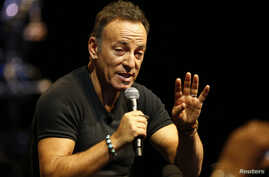FILE - Singer Bruce Springsteen talks to journalists after a sound check session ahead of his concert in Cape Town, South Africa, Jan. 26, 2014.