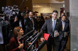 FILE - House Speaker Paul Ryan of Wisconsin walks past reporters on Capitol Hill in Washington, March 21, 2017, to meet with President Donald Trump who came to the Capitol to rally support for the Republican health care overhaul by taking his case di