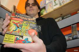 Comic book expert Scot Brimson with a rare edition of a Spider Man comic from the early 1960s, priced at almost 600 dollars. Brimson sells the latest in comic books at Cosmic Comics, a store is sandwiched between a bakery and a tire fitment center in