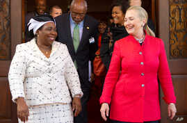 Clinton walks out with African Union Chair-Designate Nkosazana Dlamini-Zuma after their meeting at Brynterion Estate in Pretoria, South Africa, Aug. 7, 2012.