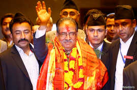 Nepal's newly elected Prime Minister Pushpa Kamal Dahal, also known as Prachanda, waves towards the media after he was elected Nepal's 24th prime minister in 26 years, in Kathmandu, Nepal, August 3, 2016.