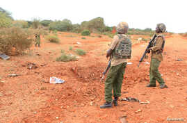 A Kenyan security person stands at the scene where a blast killed Kenyan police officers at the Garissa county, eastern Kenya, May 24, 2017.