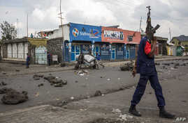 Congolese National Police patrol the street Dec. 28, 2018, at Majengo in Goma, in North Kivu province.
