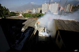 A Sucre municipality worker fumigates for Aedes aegypti mosquitoes that transmit the Zika virus in the Petare neighborhood of Caracas, Venezuela, Feb. 1, 2016.