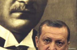 Turkey's Prime Minister Recep Tayyip Erdogan, speaks during a news conference at Ataturk International airport in Istanbul, April 4, 2014.