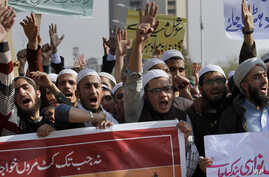 Pakistani students of Islamic seminaries chant slogans during a rally in support of blasphemy laws, in Islamabad, Pakistan, March 8, 2017. Hundreds of students rallied in the Pakistani capital, urging government to remove blasphemous content from soc...