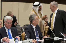 FILE - Saudi Arabia's Deputy Defense Minister Mohammed Alayeesh, second right, speaks with U.S. Secretary of Defense Jim Mattis, right, during a meeting of the counter-Islamic State Coalition at NATO headquarters in Brussels, Feb. 16, 2017.