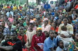 Southern Sudanese wait for food, shelter, security and medicine at the village of Nzara, along Sudan's border with DR Congo, 18 Aug 2010