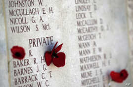 Poppies decorate a commemorating wall with the names of fallen servicemen at the Lone Pine cemetery and memorial site in Gallipoli peninsula, Turkey, April 23, 2015.
