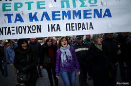 """Greek protesters march against government policies affecting pensioners in Athens, Greece, Dec. 15, 2016. The banner reads """"Bring back what you have stolen""""."""
