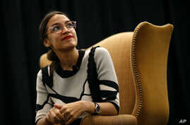 New York congressional candidate Alexandria Ocasio-Cortez participates in a town hall in support of Kerri Evelyn Harris, Democratic candidate for the U.S. Senate in Delaware, Aug. 31, 2018, in Newark, Delaware. Democrats have increasingly focused on