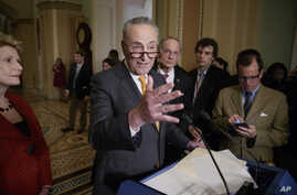 Senate Minority Leader Charles Schumer of N.Y., speaks with reporters following a closed-door strategy session, March 28, 2017, on Capitol Hill in Washington.
