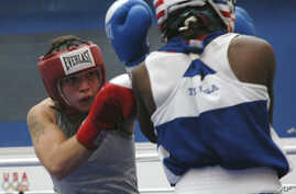 FILE - Reigning champion Patricia Manuel, of Commerce, Calif., competes in a 132-pound division at the 2010 USA boxing national championships, July 15, 2010, in Colorado Springs, Colo. Saturday night, Manuel, a transgender male, won his first profess