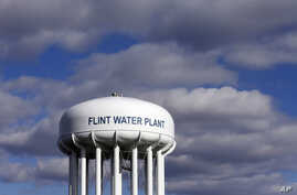 The Flint Water Plant water tower is seen in Flint, Michigan, March 21, 2016. Researchers from Virginia Tech say the lead levels in the city's drinking water is decreasing.