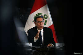 Peru's President Martin Vizcarra speaks to foreign media at the government palace in Lima, Oct. 29, 2018.