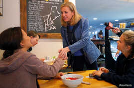 Democratic candidate for the U.S. Congress Maura Sullivan greets voters at Laney & Lu in Exeter, New Hampshire, U.S., Sept. 10, 2018.