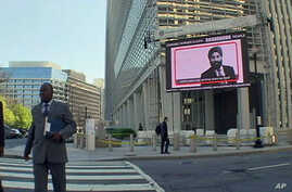 A giant electronic display outside the World Bank's headquarters in Washington, D.C., is tallying the number of chronically hungry people in the world today, April 2011