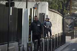 Armed police stand guard outside the French domestic intelligence agency headquarters (DCRI) in Levallois-Perret, near Paris, March 24, 2012. Abdelkader Merah and his girlfriend were transfered here from Toulouse for further questioning about the mas