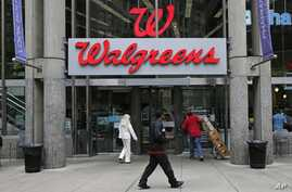 Walgreens retail store in Boston, Massachusetts, June 4, 2014. Walgreen Co. is among many companies considering combining operations with foreign businesses to trim their tax bills.