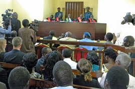 Reporters were allowed in to the packed courtroom in the morning when the treason trial of four South Sudan political detainees began on March 11, 2014, but not in the afternoon.