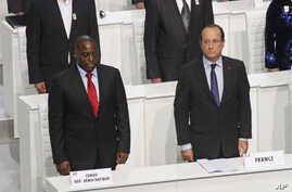 French President Francois Hollande and DRC President Joseph Kabila stand during the opening session of the Francophone Summit, in Kinshasa, DRC, Oct. 13, 2012.
