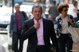 FILE - French conservative Les Republicains (LR) party member Thierry Mariani arrives at their political party headquarters in Paris, July 11, 2017.