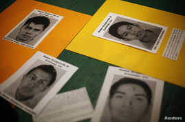 """Pictures of students from the Ayotzinapa Teacher Training College """"Raul Isidro Burgos"""", who have been missing since last month's deadly clashes, are seen during a vigil at the Instituto Tecnologico Autonomo de Mexico (ITAM) in Mexico City, October 14"""