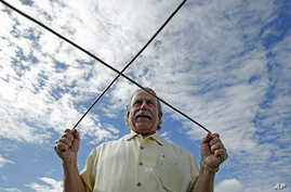 FILE - Marc Mondavi demonstrates dowsing to locate water at the Charles Krug winery in St. Helena, California.