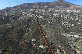 Aerial picture taken with a drone of the urban fencing on the border between the U.S. and Mexico in Tecate, northwestern Mexico, Jan. 26, 2017.