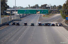California Highway Patrol police cars block the highway leading from Mexico into San Diego after the border between Mexico and the U.S. was closed in the San Ysidro neighborhood of San Diego, California, U.S. November 25, 2018.