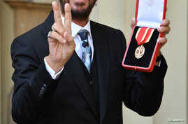 Ringo Starr, whose real name is Richard Starkey, poses after receiving his Knighthood at an Investiture ceremony at Buckingham palace in London, Britain, March 20, 2018.