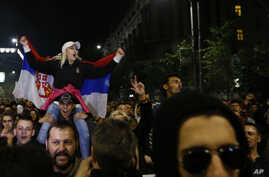 A protester holds a Serbian flag during a protest march in Belgrade, Serbia, April 5, 2017. Several thousand mostly young people have rallied for the third day against the victory of Serbia's powerful Prime Minister Aleksandar Vucic at last weekend's
