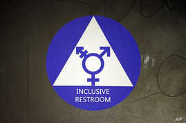 A sticker designates a gender neutral bathroom at Nathan Hale high school, May 17, 2016, in Seattle.