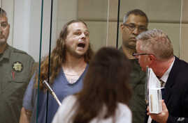 Jeremy Joseph Christian shouts as he is arraigned in Multnomah County Circuit Court in Portland, Oregon, May 30, 2017.