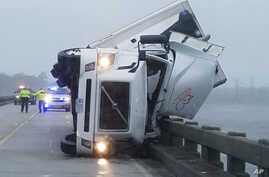 Tropical Weather-Hermine: In this photo provided by Tyrrell County Sheriff's office shows a tipped over 18-wheeler in Columbia, N.C., on Saturday, Sept. 3, 2016.