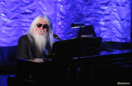 FILE - Inductee Leon Russell performs during the Songwriters Hall of Fame awards in New York, June 16, 2011.