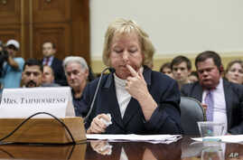 Jill Tahmooressi, mother of Marine Sgt. Andrew Tahmooressi of Weston, Florida, who has been held for six months in a Mexican jail, reads his letters from confinement, during a House Foreign Affairs subcommittee hearing on Capitol Hill in Washington,