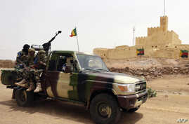 FILE - This file picture dated July 29, 2013 shows Malian soldiers patrolling in Kidal, northern Mali.