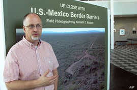"""Kenneth Madsen, an Ohio State University-Newark geography professor and border wall expert, discusses his photo exhibit of border wall pictures and maps, """"Up Close with U.S.-Mexico Border Barriers,"""" in Newark, Ohio, Sept. 14, 2018."""