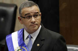 In this June 1, 2012 file photo, El Salvador's President Mauricio Funes stands in the National Assembly before speaking to commemorate the anniversary of his third year in office in San Salvador, El Salvador. The Nicaraguan government said Tuesday, S