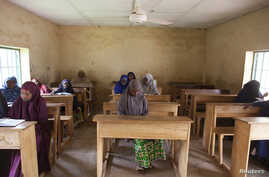 Women study Hadith excerpts at Maska Road Islamic School in Kaduna, July 16, 2014.